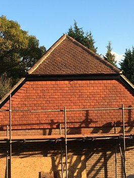 Pitched roof and vertical tiling roofer