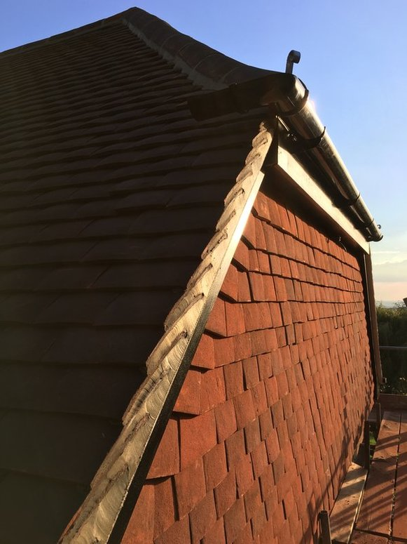 Pitched roofing and vertical clay tiles from John Brown Roofing covering Hampshire Berkshire and Surrey